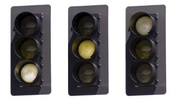 Traffic lights seen by people with red-green colourblindness, where all the lights appear in shades of yellow.